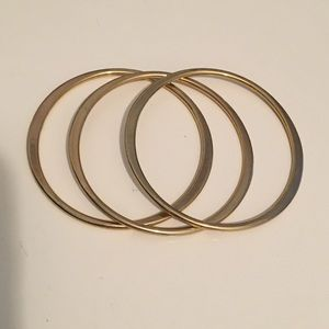 Set of 3 gold skinny bangles.